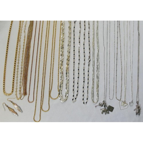 338 - A quantity of modern silver, silver coloured metal and gold plated chains, pendants and necklaces, a...
