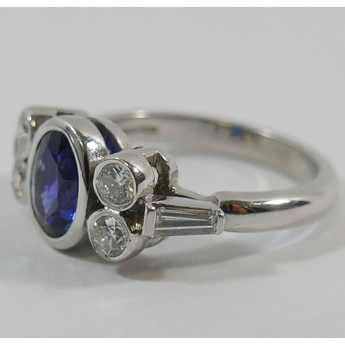 347 - An 18 carat white gold sapphire and diamond five stone ring by Nick Kellett, London 2005, the oval m...