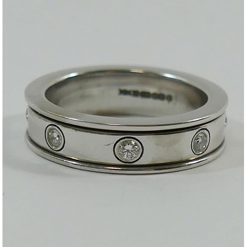 352 - An 18 carat white gold and diamond spinning eternity ring, London 2008, by Nick Kellett, the revolvi...