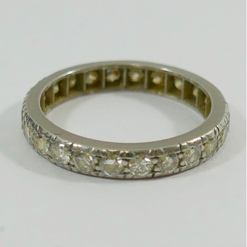 362 - An early 20th century diamond eternity ring, the 24 small round old-cut diamonds each approximately ...