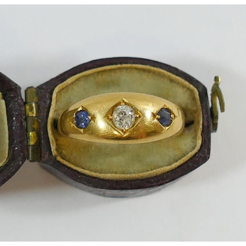 363 - An 18 carat gold diamond and sapphire three stone ring, the old cut diamond approximatley 0.10 carat...