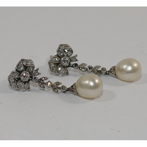 367 - A pair of early 20th century diamond and pearl drop earrings, each set with a single 6mm long pearl ...