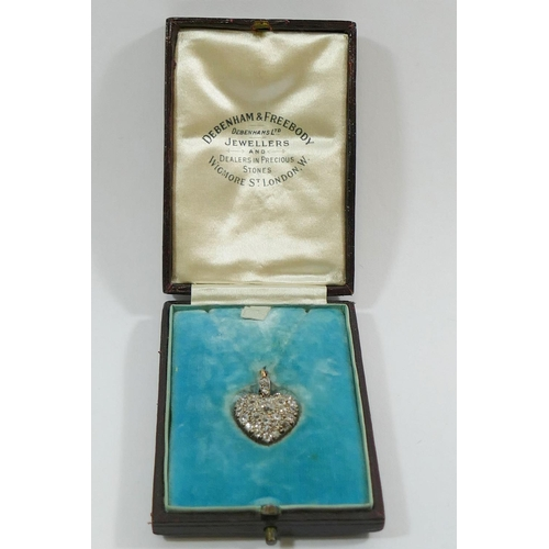 368 - A diamond set heart-shaped pendant the old cut diamonds in open back setting the centre stone approx...