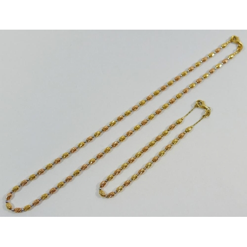 372 - A tri-colour beaded necklace on yellow metal chain, stamped '750', 40cm long, and matching bracelet,...