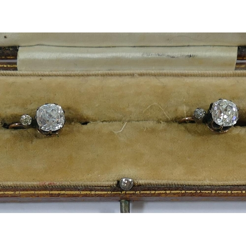 373 - A pair of 19th century gold and silver clear paste set earrings, each with a cushion-shaped mixed-cu...