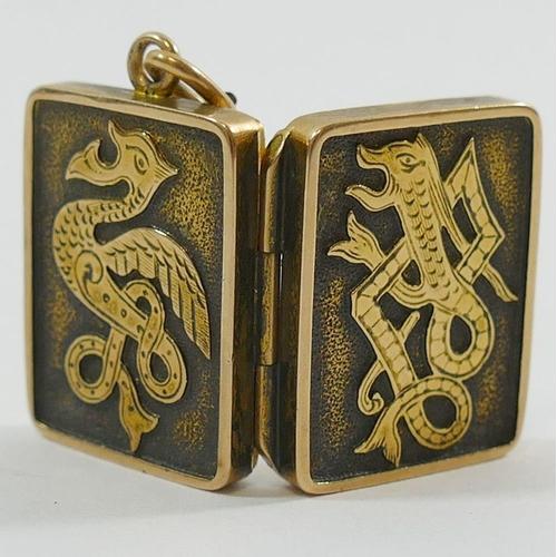 375 - A Victorian rectangular gold locket with serpent design, 2.3cm x 1.8cm, 9.1g gross...