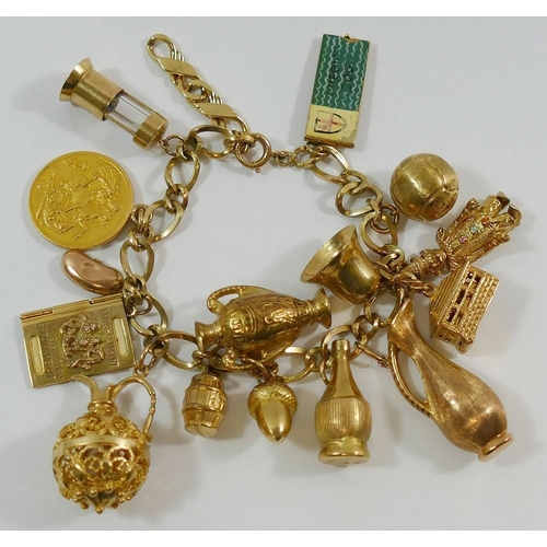 380 - A 9 carat gold bracelet with 13 9 carat gold charms, two yellow metal unmarked charms and a George V...