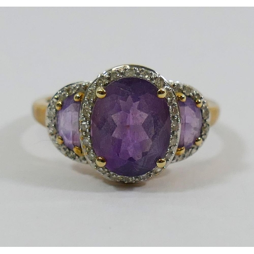 382 - A 9 carat gold amethyst and diamond triple cluster ring, Birmingham 2007, the central oval mixed cut...