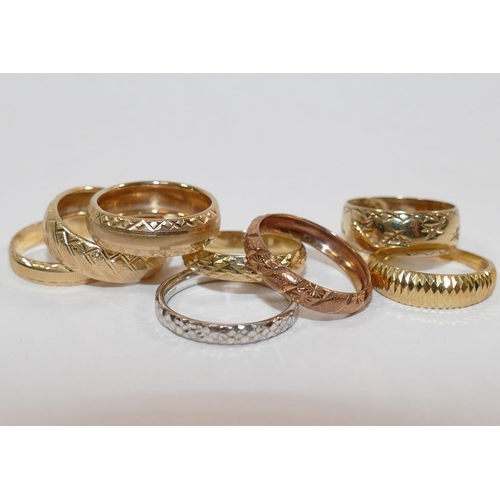 383 - Four 9 carat gold bands, combined weight 9g, two yellow and rose coloured bands,stamped '9KT' and '9...