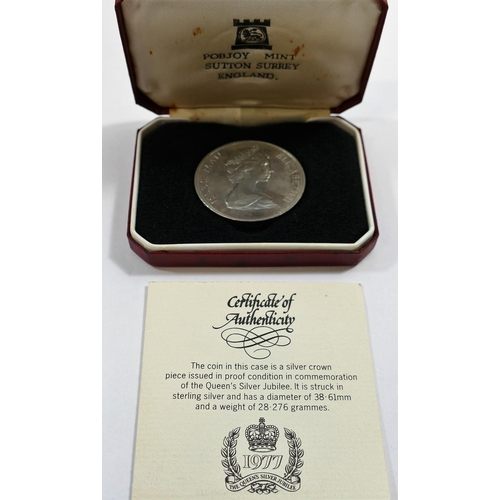 386 - A silver five pound coin commemorating the diamond wedding anniversary of Queen Elizabeth and Prince...