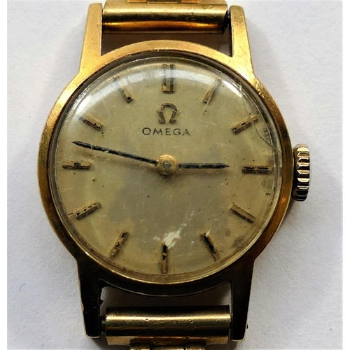 392 - A ladies 9 carat gold cased Omega wrist watch, London 1967, the circular silvered face with gilt bat...