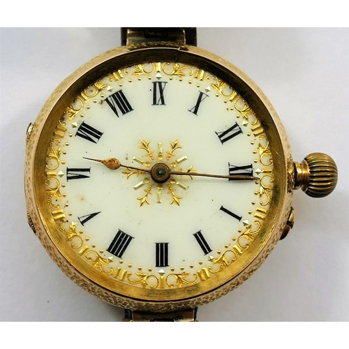 393 - A Continental yellow metal cased pocket watch, converted to a wrist watch, the white enamel face wit...