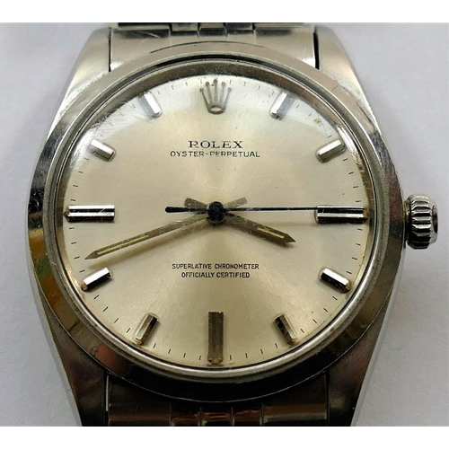 394 - A Rolex Oyster-Perpetual gentleman's wrist watch, the silvered dial with baton numerals and  inscrib...