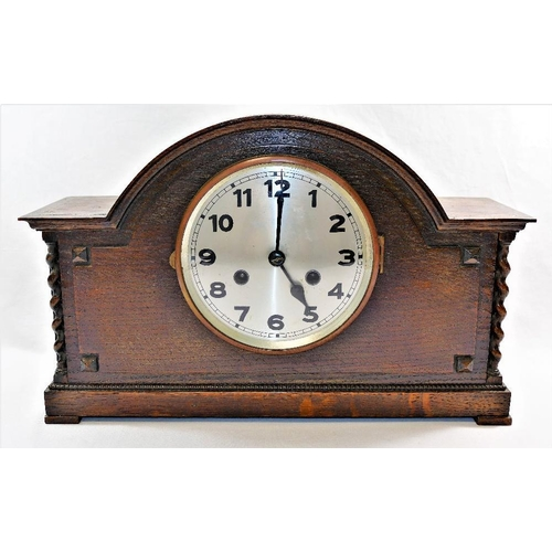 398 - An Art Deco dome top mantle clock, the case with inlaid geometric design , with Haller movement stri...