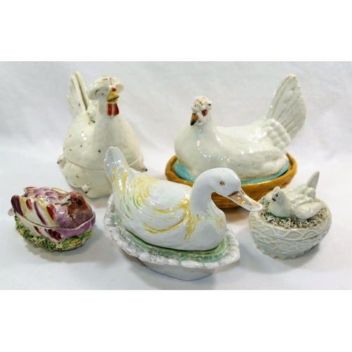 4 - A Staffordshire pottery lidded box in the form of a chicken with her chicks, 16cm high, a smaller po...