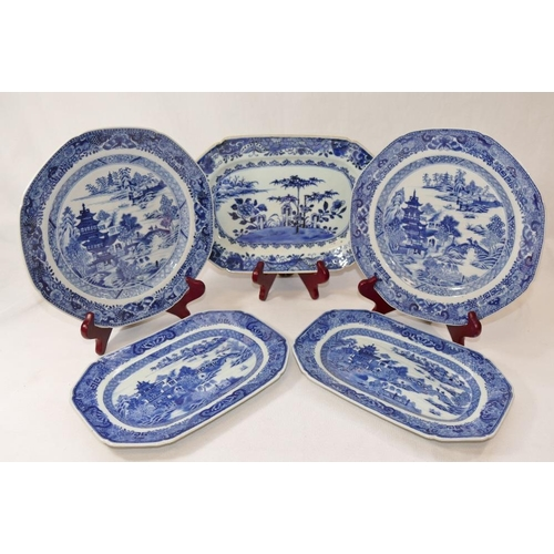 41 - A pair of 19th century Chinese porcelain blue and white plates, with typical pagoda, bridge and isla...