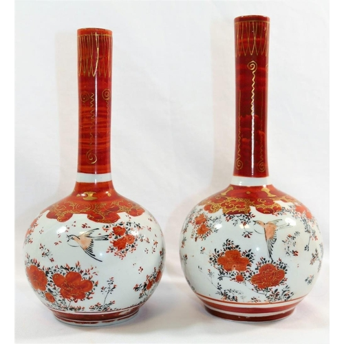 44 - A pair of 20th century Japanese porcelain Kutani vases, with spherical bodies and narrow cylindrical...