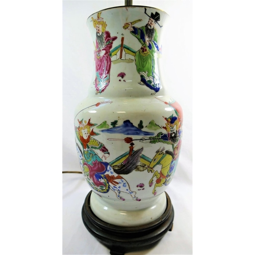 45 - A 19th century Chinese famille rose vase, decorated in enamels with a battle scene, converted to a l...