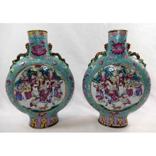 48 - A pair of Chinese famille rose porcelain moon flasks, with Tongzhi mark, decorated with figural pane...