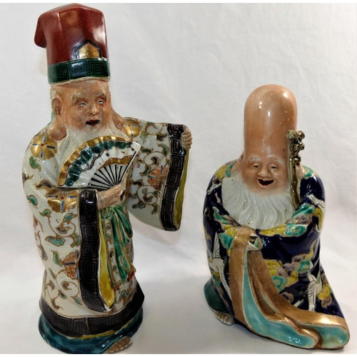49 - Two Japanese pottery glazed, polychrome enamel and gilt decorated figures of immortals, 22cm high an...