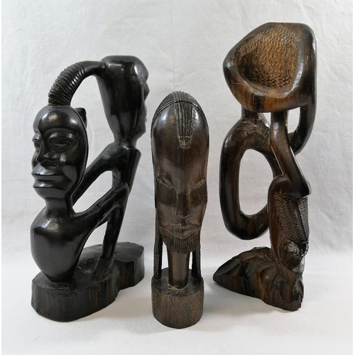 54 - A collection of nine African carvings and sculptures including a pair of masks and a wooden club, 50...