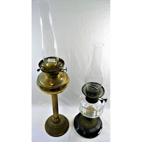 57 - A Victorian brass oil lamp with reeded column, and another oil lamp with panel cut glass reservoir, ...