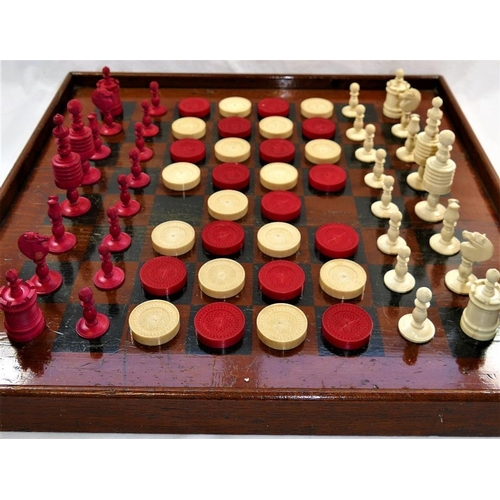 62 - A 19th century turned and stained carved ivory and bone chess set, the tallest piece 9.2cm high, and...