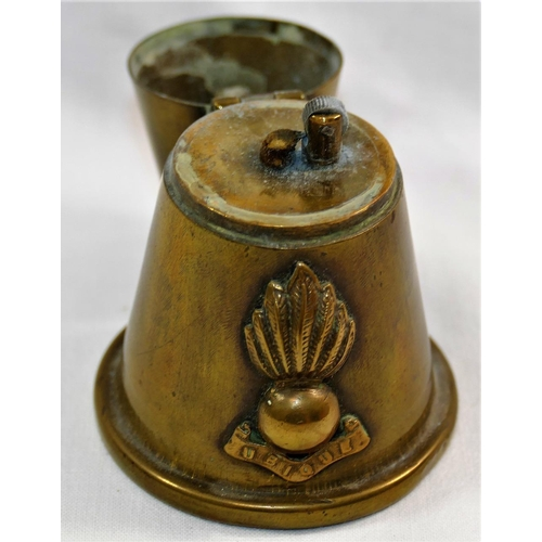 65 - A Royal Artillery brass shell lighter made from the tip of a shell with brass button mounted to the ...