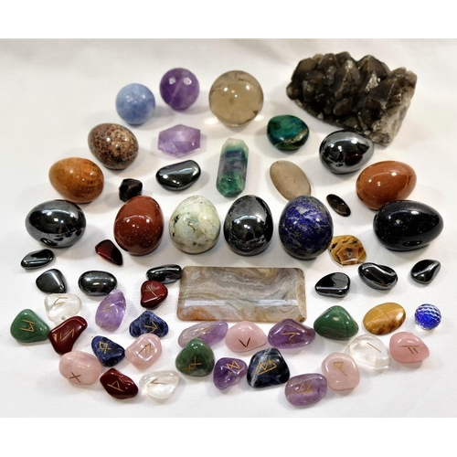 68 - A small rock crystal ball, 4.5cm diameter, a collection of polished rune stones, various hardstones ...