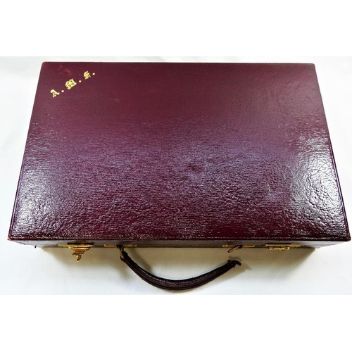 71 - A maroon leather bound writing case, with fitted interior and with gilt metal mounts, 35.3cm x 23cm ...