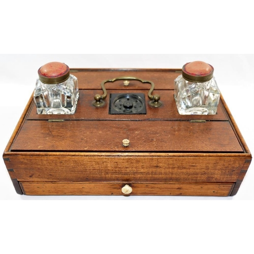 76 - A 19th century mahogany table top writing desk stand, comprised of two glass ink wells, a drawer and...