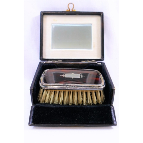 96 - A George V silver and tortoiseshell backed rectangular hairbrush, Birmingham 1927 by William Hutton ...