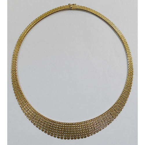 281 - A 9 carat gold fringe necklace, import marks for Birmingham 1990, the links decorated with a repeati...