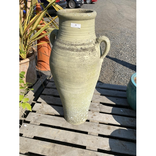 39 - A tall terracotta vase modelled in the Grecian style...