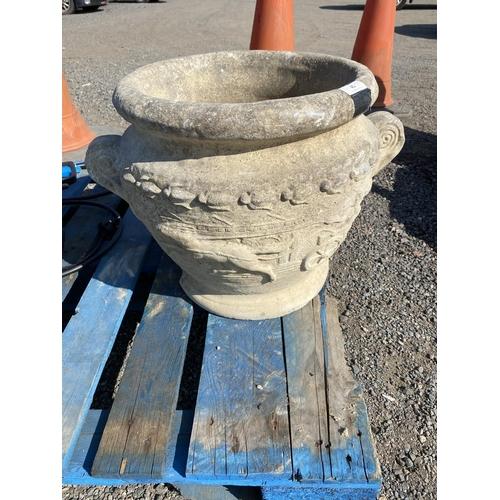 42 - A reconstituted stone garden urn...