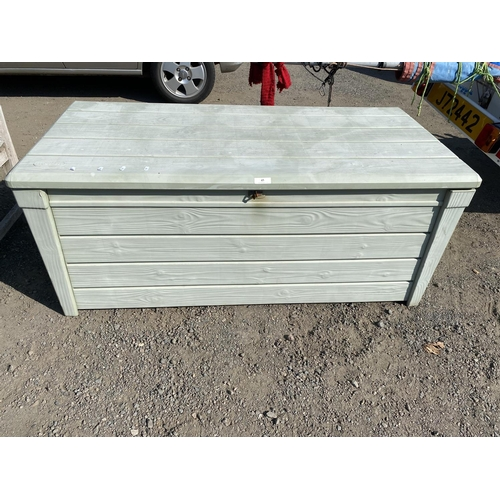 45 - A Keter exterior storage box containing a quantity of green coloured garden furniture cushions...