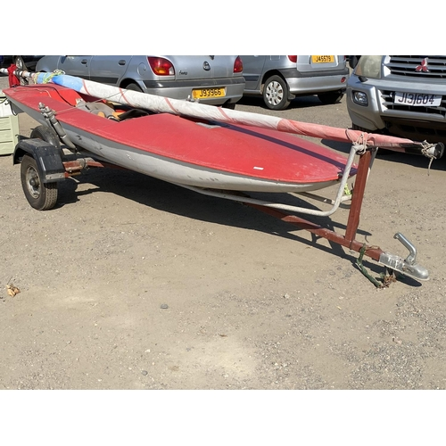 46 - A Topper sailing dinghy complete with road trailer, launching trolley, accessories and trailer board...