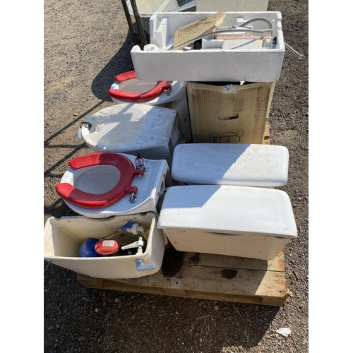 54 - Three white WCs and cisterns, assorted air filters etc. - all new...