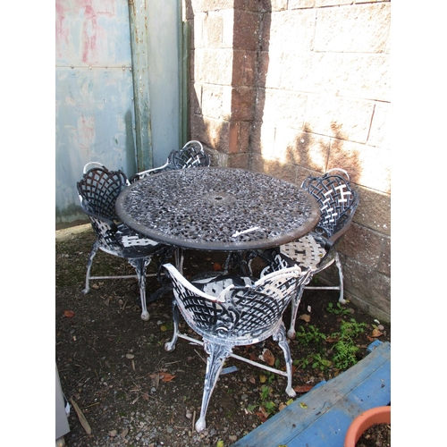 52 - A pierced aluminium circular garden table together with four matching chairs