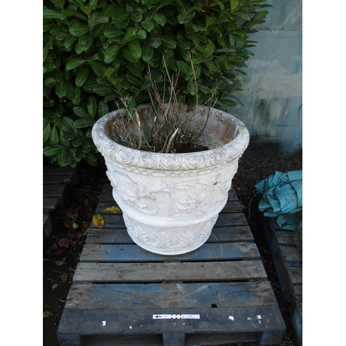 55 - A large reconstituted stone garden urn in the Neo Classical style