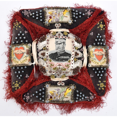 435 - A Boer War pin cushion,  in the form of Maltese Cross with studded charcoal grey panels edged with c...