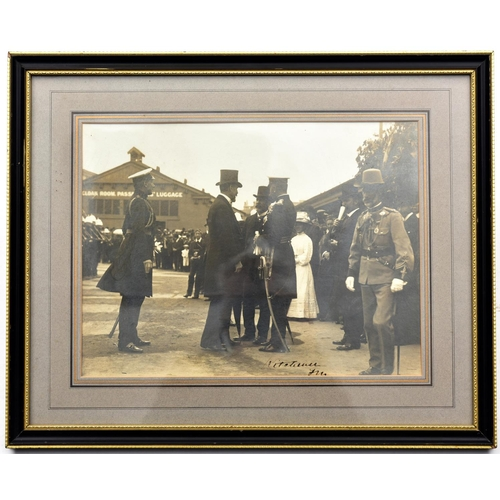 402 - An early 19th century signed photograph of F. Marshal Lord Kitchener, wearing peaked cap and frock c...