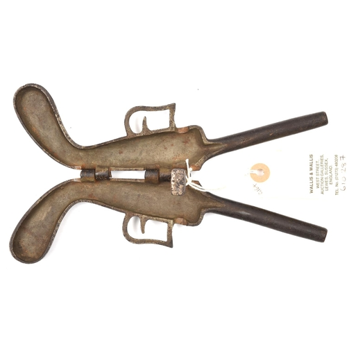 """434 - A 19th century cast iron novelty folding boot jack, in the form of a double barrelled pistol, 8"""" ove..."""