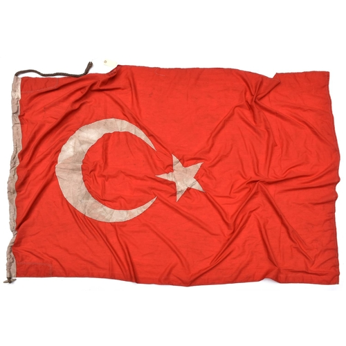 436 - A white on red double sided flag with applied Ottoman star and crescent, the hoist stamped with spur...