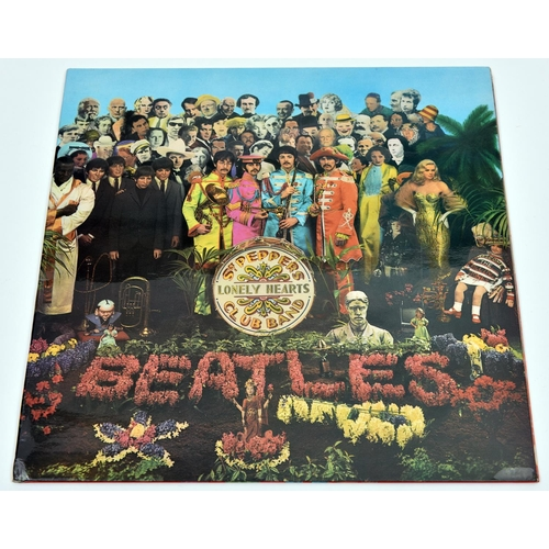 124 - The Beatles - Sgt. Pepper's Lonely Hearts Club Band. Parlophone stereo 12