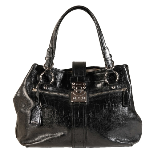 450 - A BLACK LEATHER DKNY LADIES SHOULDER BAG with a silver metal buckle embossed 'DKNY', width 42cm, hei...