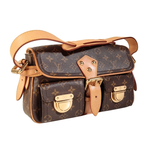 454 - A LOUIS VUITTON MONOGRAMMED HANDBAG, the two front pockets with LV hardware, buckle fastener, adjust...