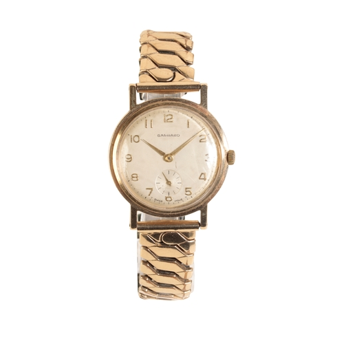 10 - GARRARD 9 CT GOLD GENTLEMAN'S WRIST WATCH with manual wind movement the silver dial with gold Arabic...