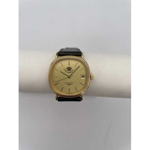 21 - LONGINES GOLD PLATED GENTLEMAN'S WRIST WATCH with manual wind movement the gold Khanjar dial commiss...