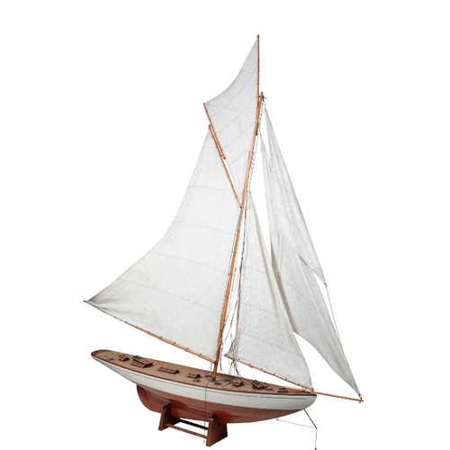 214 - A VINTAGE POND YACHT the sloop with a white painted hull and a large mainsail, the hull 120cm, and t...